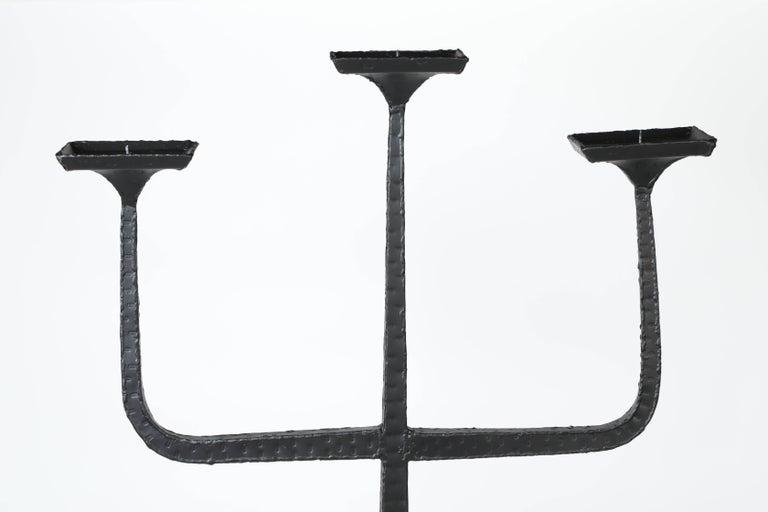 Tall vintage three-arm iron candelabra stand with black powder coat finish.