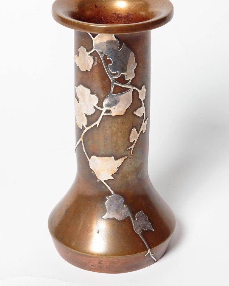 Beautiful circa 1920s Arts & Crafts, Art Nouveau patinated bronze vase, noteworthy sterling foliage-motif overlay, a marvellous eyecatcher on any tabletop. Offered by Funky Finders.