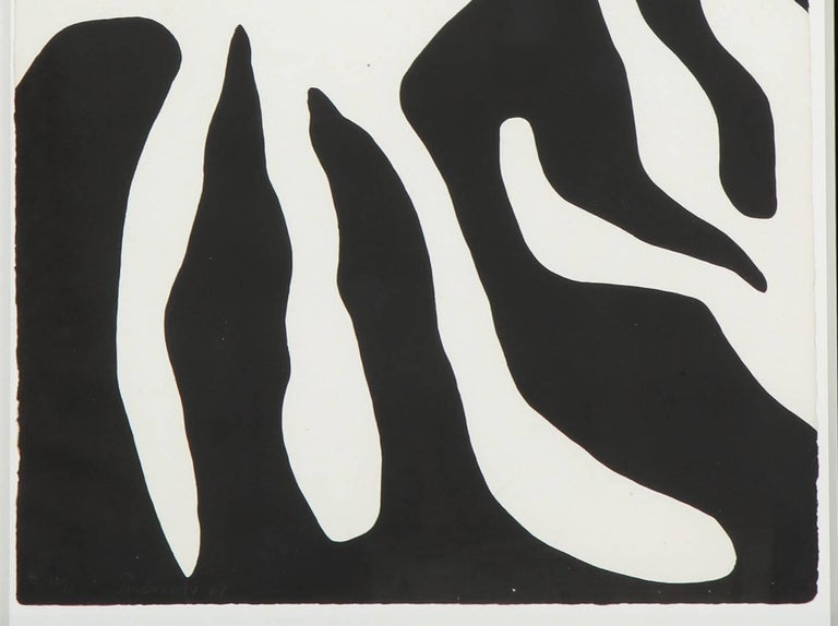 An abstract screen-print of a leaf form by William Turnbull (Scottish 1922-2012) in a black frame. We have a second print by the same artist in our collection.
