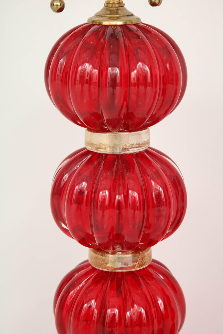 Add some color and personality to a room with these gorgeous red Murano glass lamps. Composed of three fluted