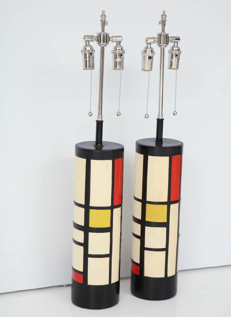Pair of lamps covered in different colored leather in Mondrain style.