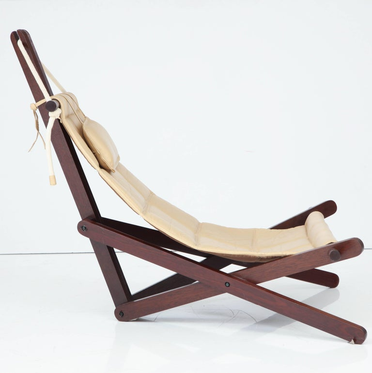 Intricate designed cream colored leather and jatoba wood sling chair by English Architect Dominic Michaelis called the