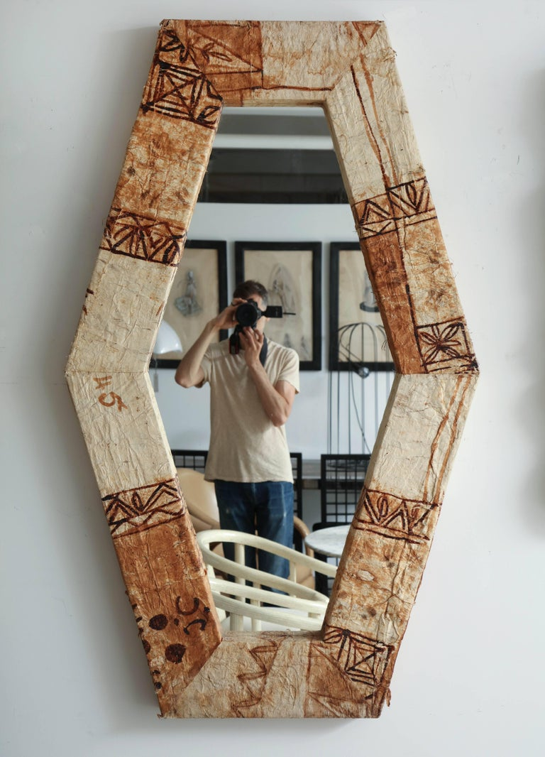 Six sided long mirror covered in tapa cloth from Polynesian Islands.
