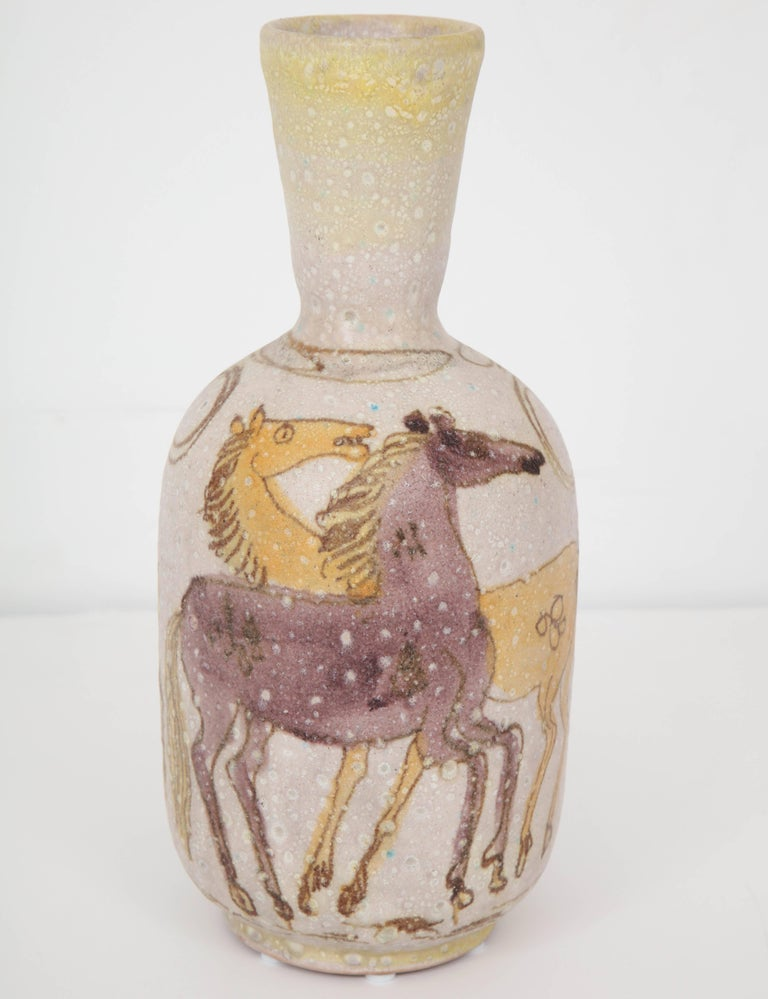 A beautifully painted vase with horses made in the early 1950s by Guido Gambone, post-war Italy's most celebrated ceramist.  Signed with the artist's famous