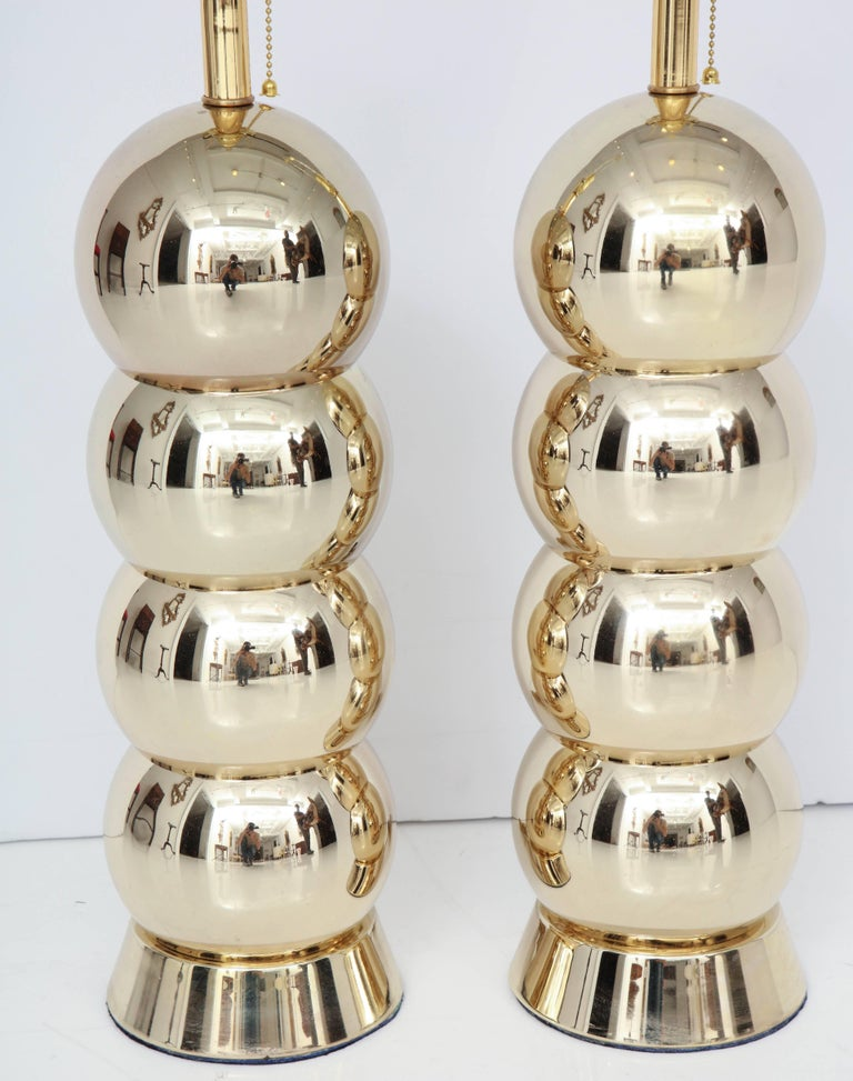 Decorative brass table lamps, circa 1950. The pair of lamps have been brass-plated. They are in very good condition.