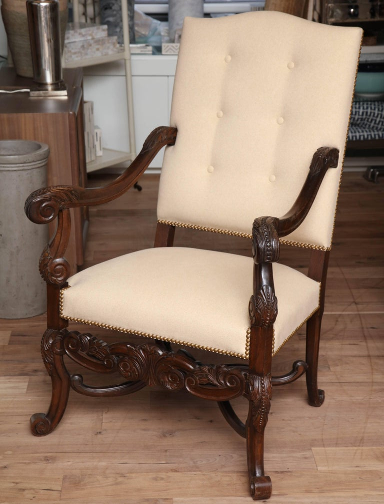 Hand-carved 19th century armchair from Belgium upholstered in flannel suede with tufted back and French natural nailhead trim.