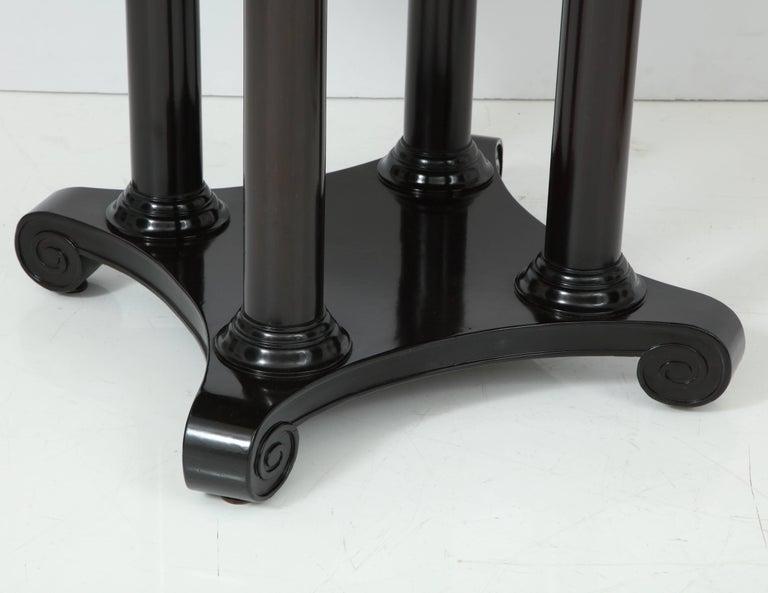 Translucent ebony-finished mahogany 19th century French column base center or dining table.