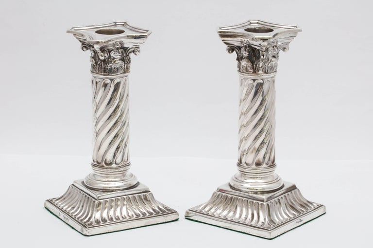 Rare, unusual pair of sterling silver, Victorian, neoclassical design, Corinthian column candlesticks, London, 1891, Martin and Hall - makers. Measures: 6 inches high x 3 1/4 inches wide x 3 1/4 inches deep. Weighted. Removable bobeches. Columns are