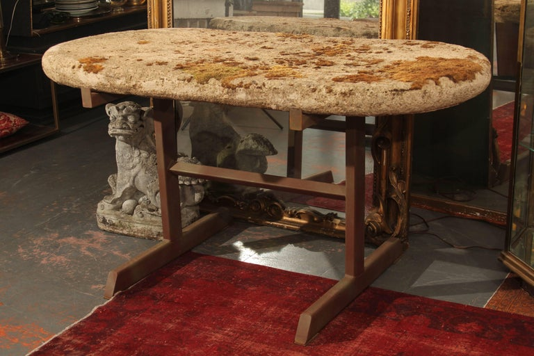 Moss covered antique cast stone top garden table on vintage metal base. Can be used inside or out- would be perfect entry table. Top is approximate 3 1/2 inch thick.