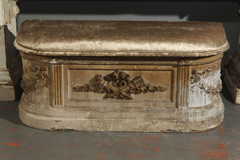 Beautifully distressed bench with hinged, lift top upholstered in velvet with hidden storage. Perfect for hallway , foot of a bed or nook . Beautiful patina of white, greys and old gilding, 19th century, France.