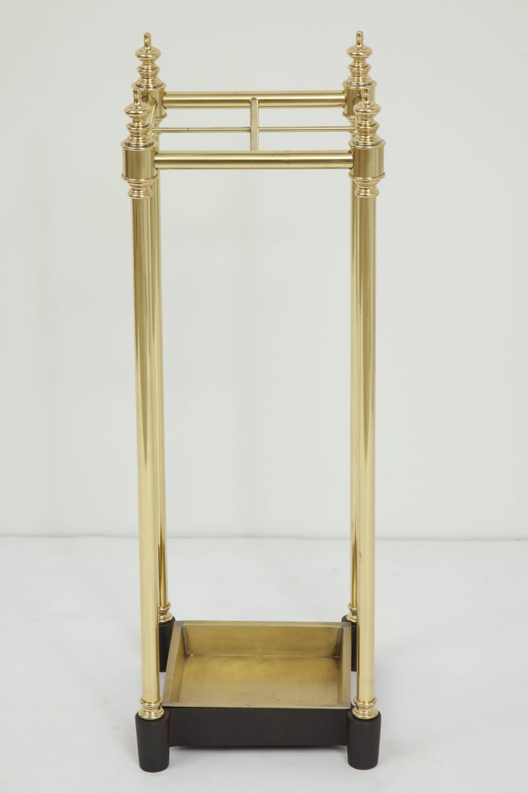 Art Deco brass and cast iron umbrella stand. The brass body is finished off with stylized spire finials, cast iron base gives piece weight which ensures placement. Professionally repolished.