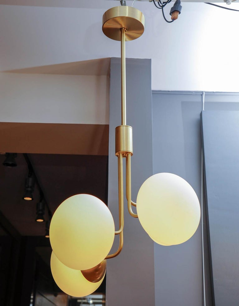 Italian Satin Brass Suspension with Four Lights and Round White Glass Globe For Sale