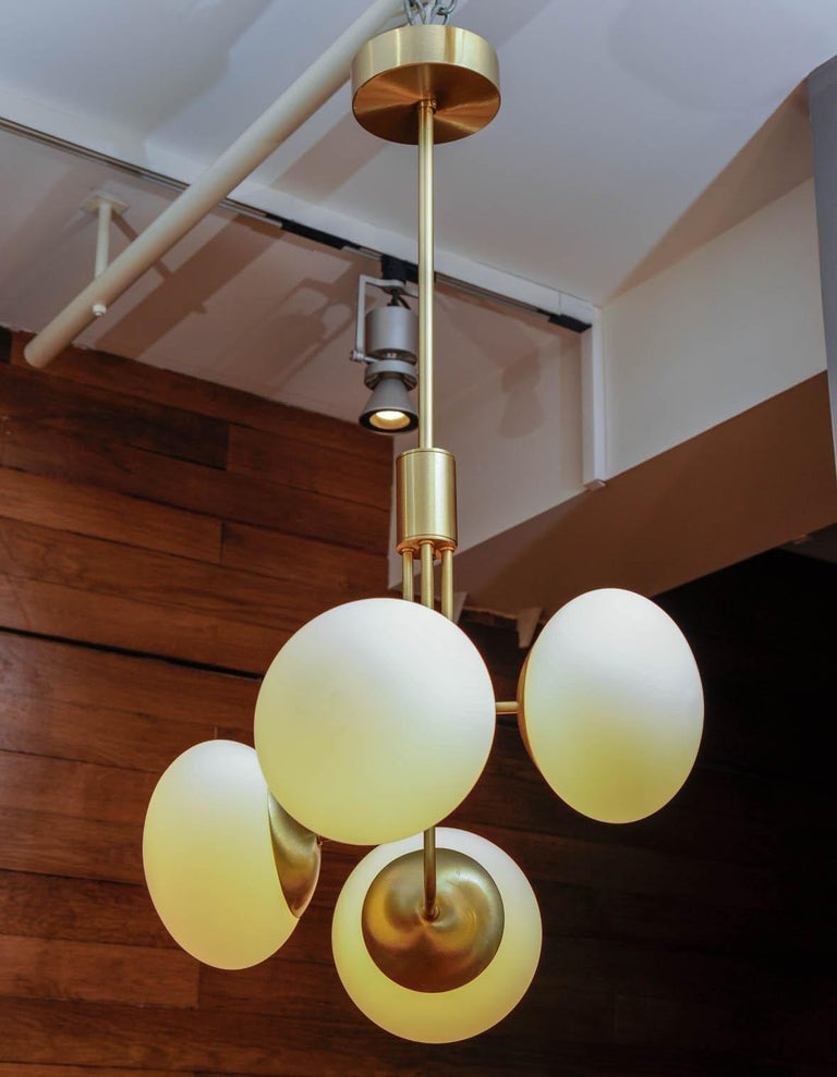 Satin Brass Suspension with Four Lights and Round White Glass Globe For Sale 1