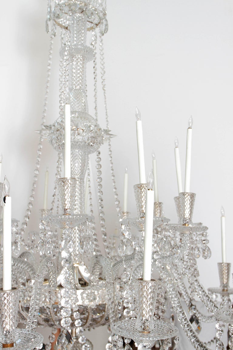 Faceted Pair of Majestic 24-Light Cut Crystal Chandeliers For Sale