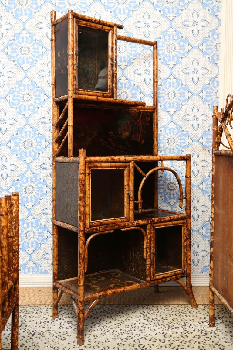 Superb 19th century English bamboo cabinet with three glass cabinet, leather paper and japanning.