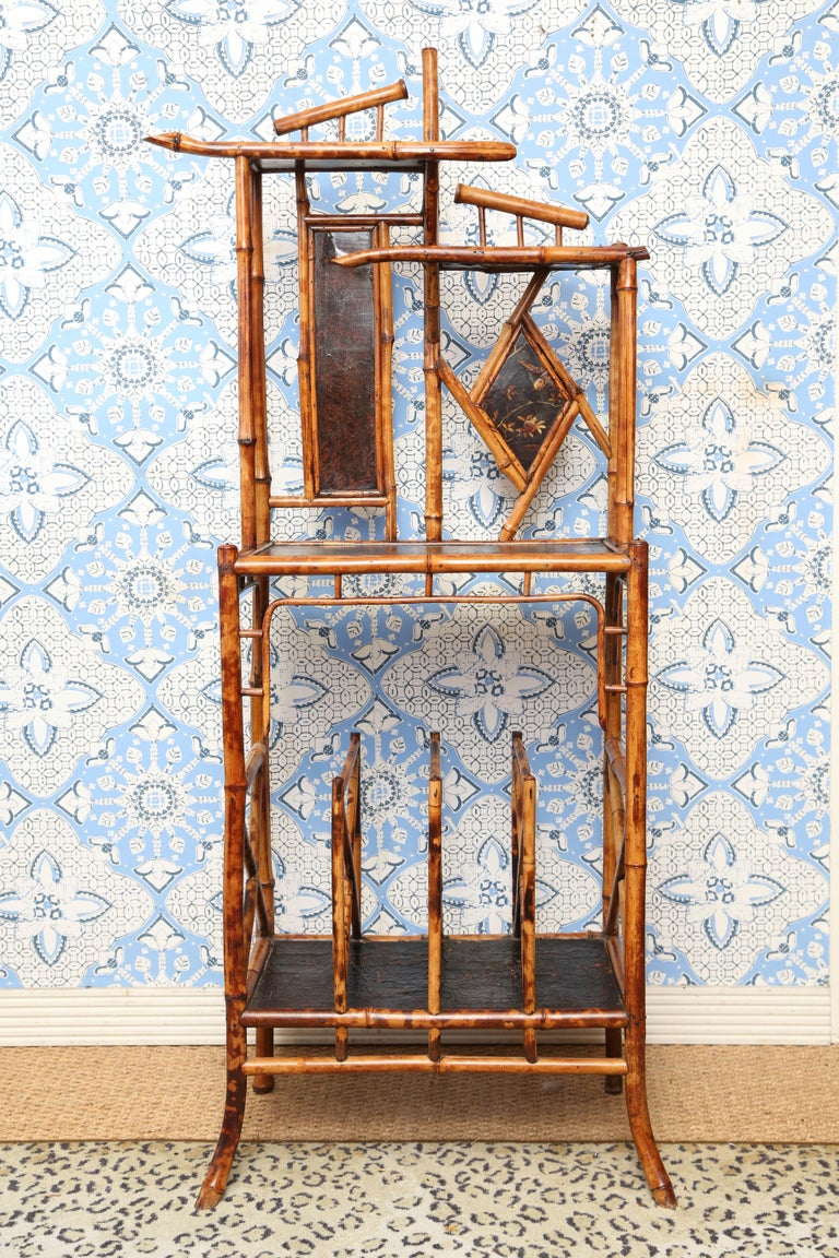 Superb 19th century English Bamboo Magazine rack with tabletop with Japanese figurines and leather paper.