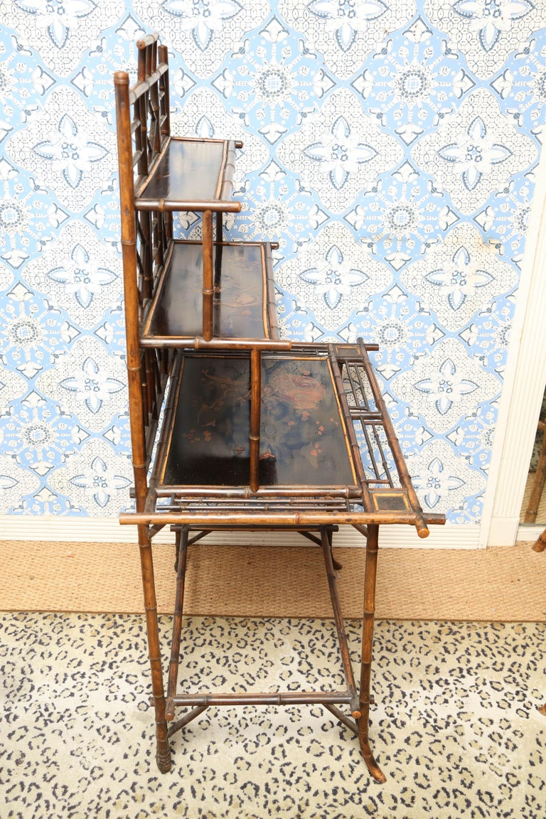 Superb and sophisticate 19th century English bamboo server or etagere .    with black lacquer floral and bird decorations. Approximate 57 1/2