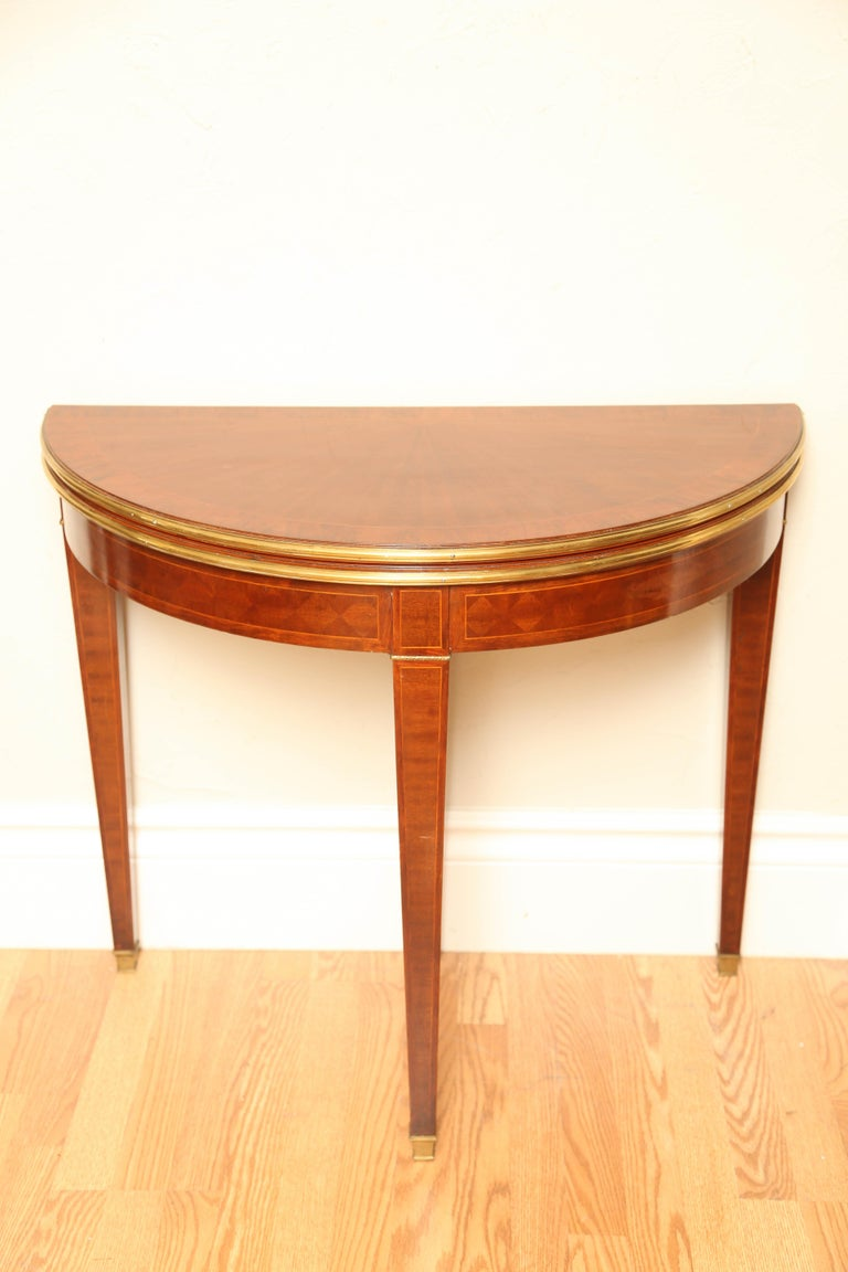 Antique french demilune card table or console with embossed leather top opens to a 35