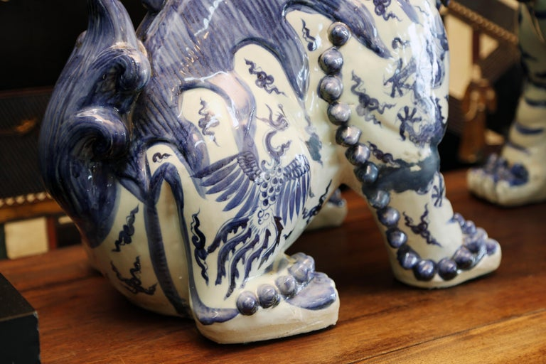 Chinese Export Pair Blue and White Chinese Foo Dogs Hand-Painted, Private Chinese Collection For Sale