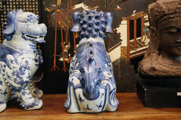 Asian Pair Blue and White Chinese Foo Dogs Hand-Painted, Private Chinese Collection For Sale