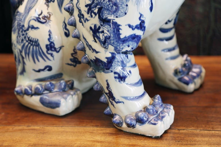 Contemporary Pair Blue and White Chinese Foo Dogs Hand-Painted, Private Chinese Collection For Sale
