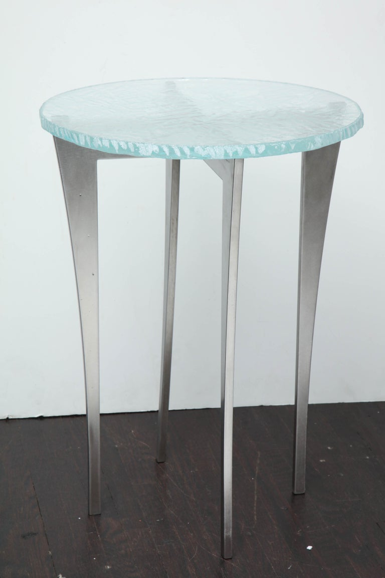 Cast star fire glass, cut with hand chiseled edge with curving stainless steel base.