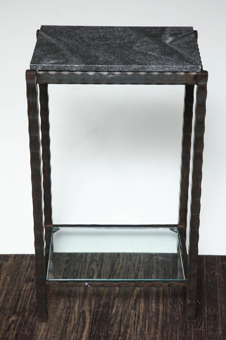 Top: Dazzling dark gray granite Bottom shelf: Clear glass Frame: Hammered steel with black wax patina.