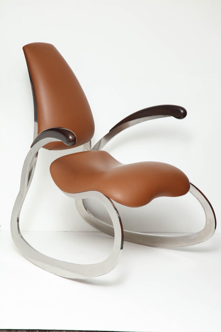 Calf skin seating Stainless steel frames Wenge wood armrests.