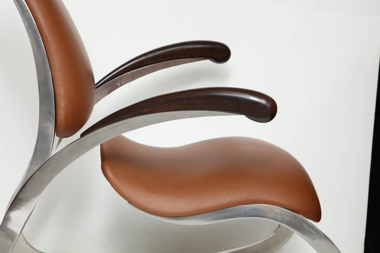 Stainless Steel Organic Body Rocking Chair with Dynamic Curving Steel Frames For Sale