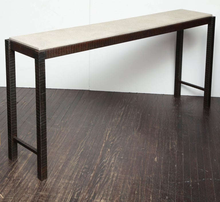 Embossed Edelman leather shagreen console with hand forged patented steel.