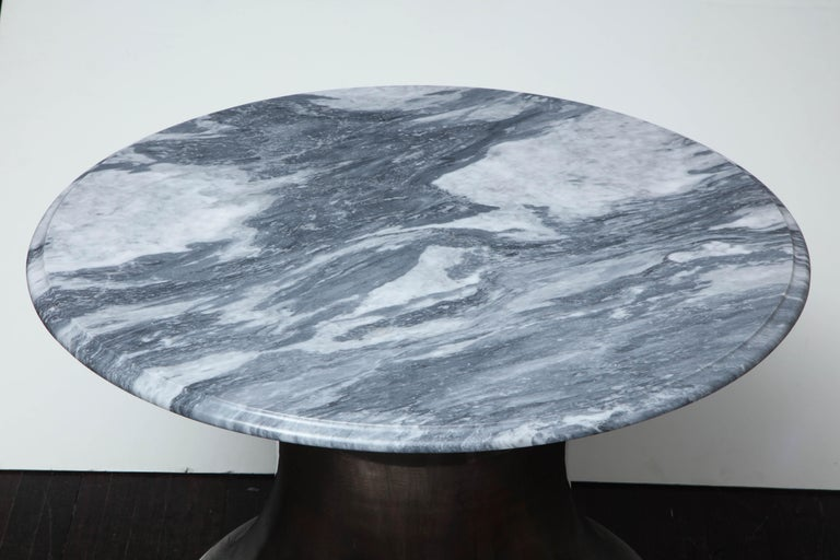 Beautiful cloud gray marble coffee table with elegant Olpe shaped stainless steel base.