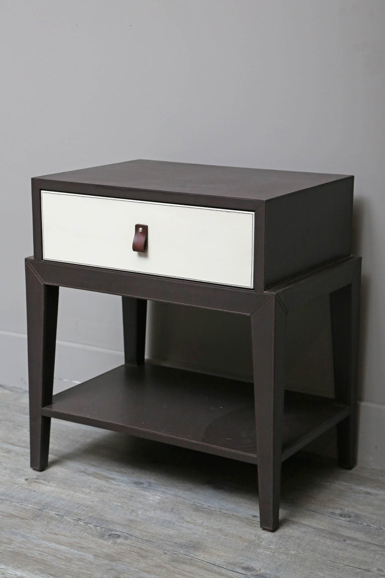 Supple Italian leather nightstand designed by Serge de Troyer. Drawer is lined with suede.