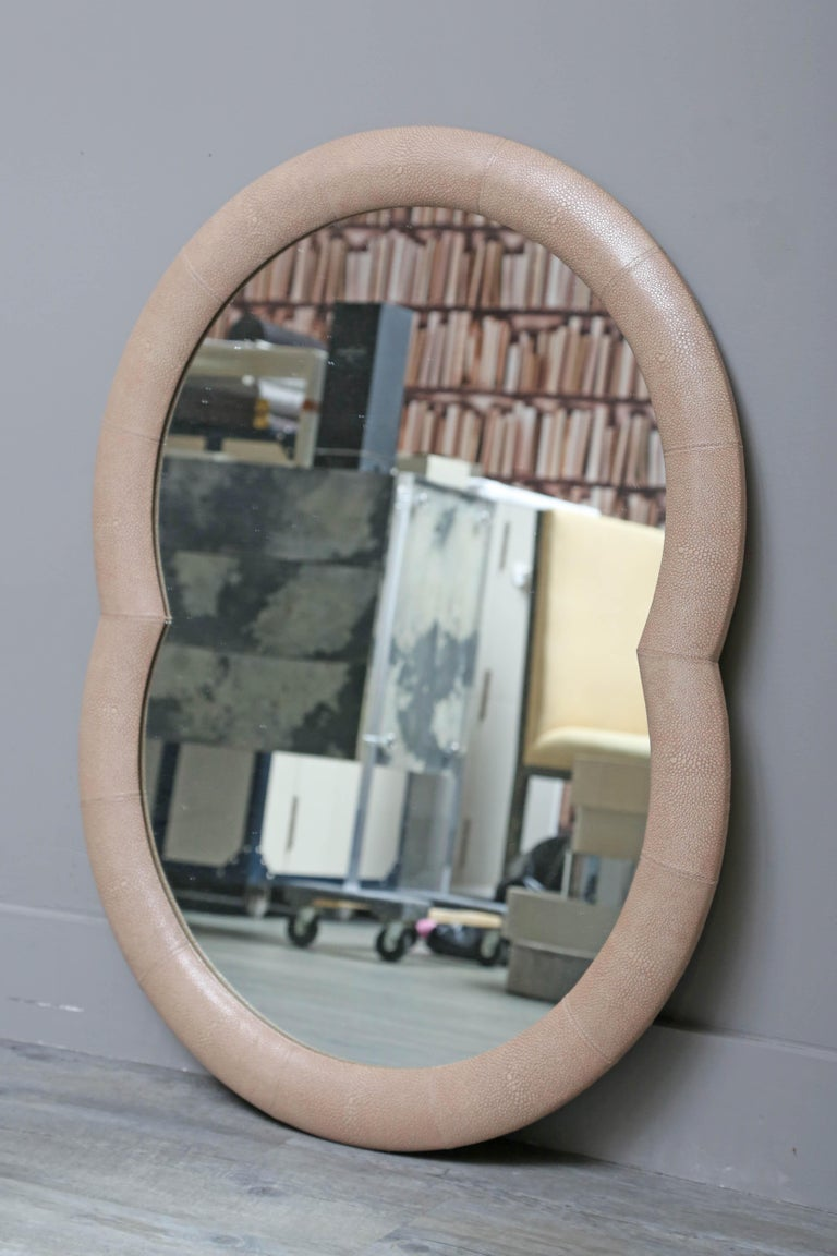Double circle leather mirror.