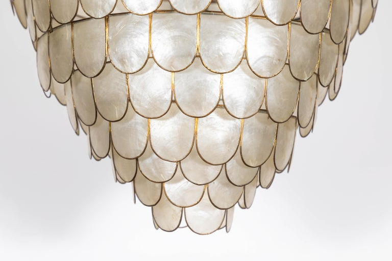 French Art Deco scalloped capiz shell pendant with brass details.