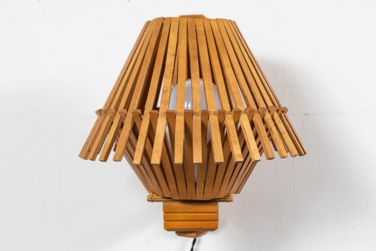 French pair of Geometric angled wood slatted sconces. Plug in with twist switch.