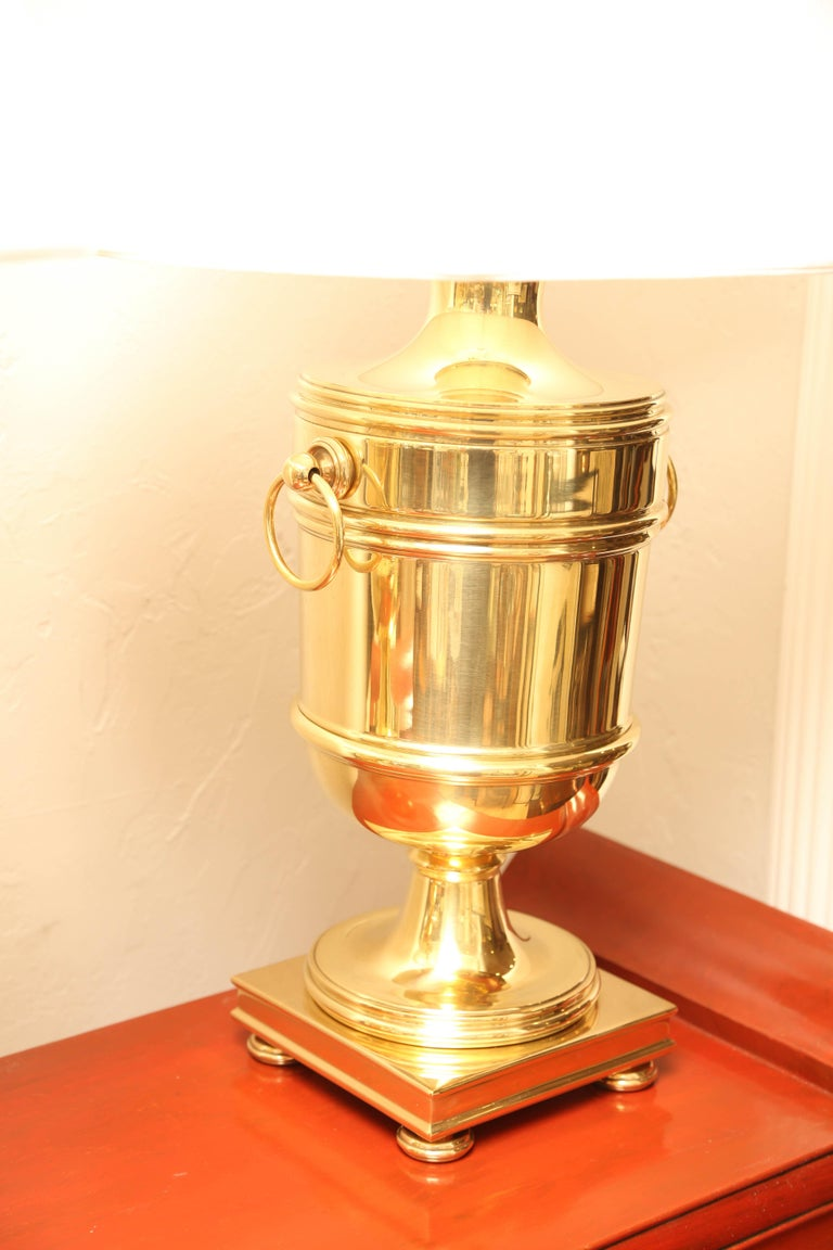 Large pair of brass urn lamps with adjustable harps by Ralph Lauren. Measures: New shades with a 19