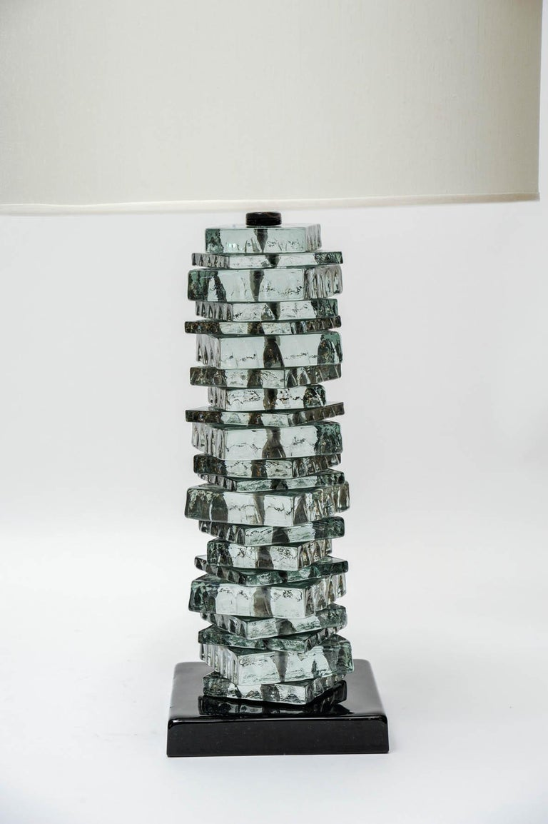 Pair of Murano glass table lamps made of a stack of square tiles with rough edges.