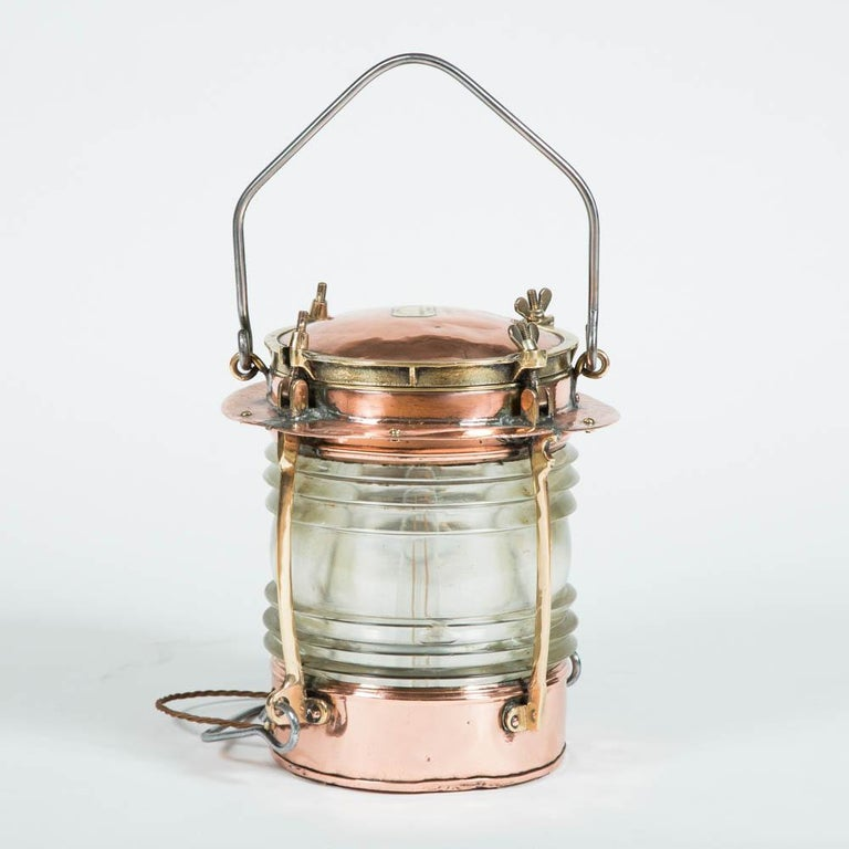 A pair of copper and brass ships lights by Telford, Grier, Mackay & Co of Glasgow, with Fresnel drum lenses by Chance Brothers of Smethwick.  Measures: Height (hanging) 75 cm  Height (standing) 34 cm  Diameter 30 cm   Re-wired for mains