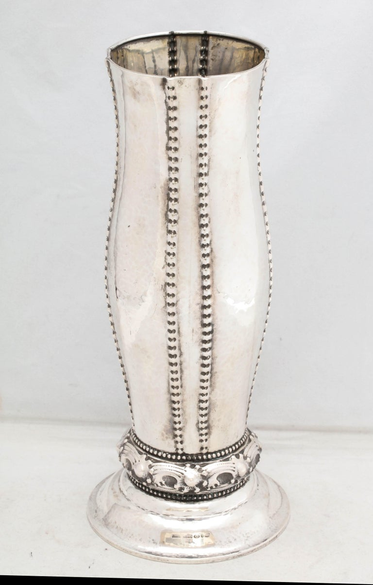 Art Deco, continental silver (.830) vase, Norway, circa 1910, David Andersen - maker. Hammered silver is decorated with beaded design. Measures 11 1/4 inches high x 5 inches diameter across base x 3 1/2 diameters across opening. Weighs 15.530 troy
