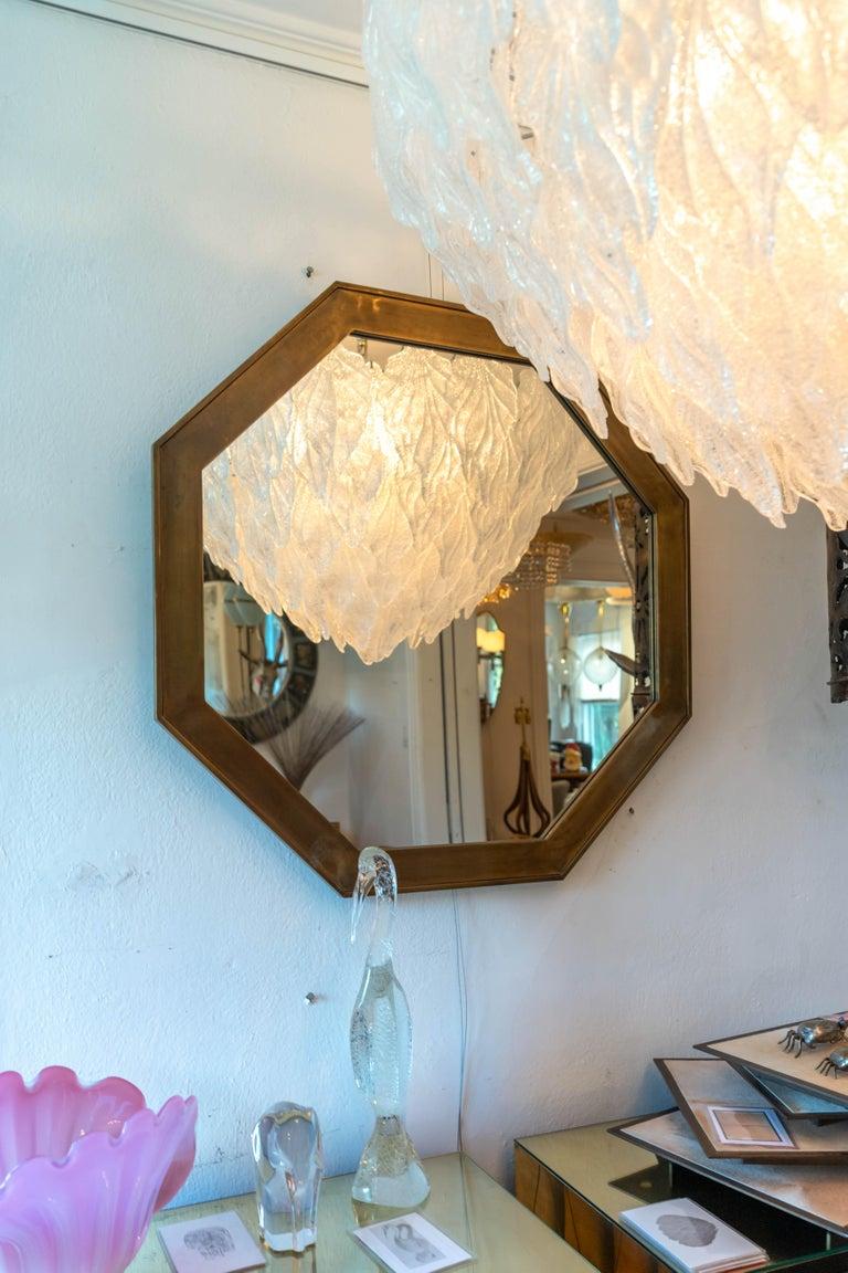 Octagonal patinated surround mirror, by Mastercraft.