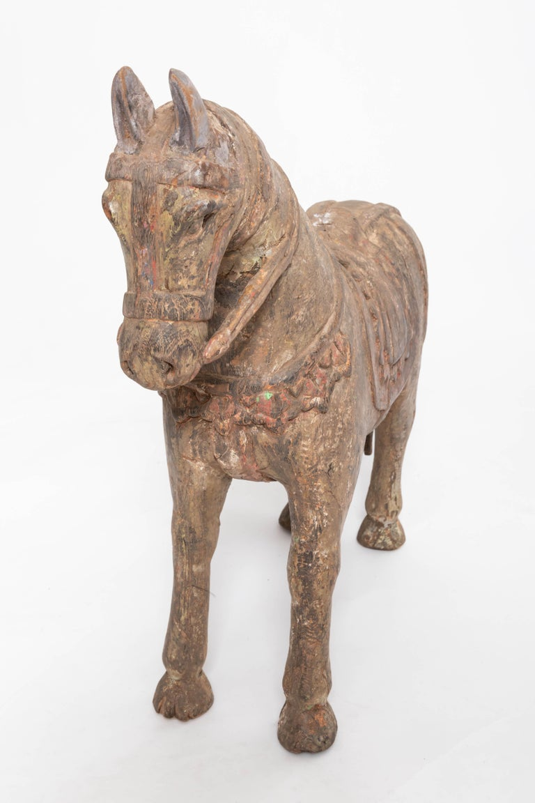 Hand carved wooden horse.