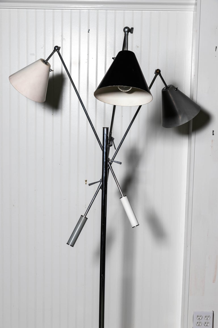 Early Arredoluce floor lamp with black, grey and white shades with tripod base. Designed by Angelo Lelli.