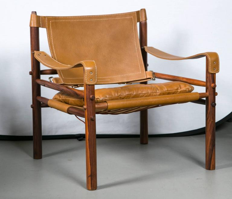 Arne Norell rosewood and leather safari chair. Excellent Original condition.