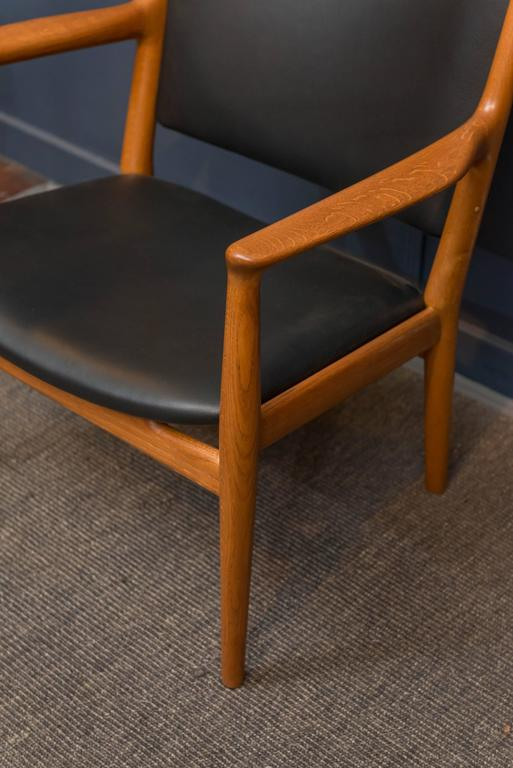 Hans J Wegner design oak and teak lounge chair model JH-713 for Johannes Hansen, Denmark. Simple elegance combined with high quality construction and restorations make for the perfect robust lounge chair.  New leather upholstery, labeled.