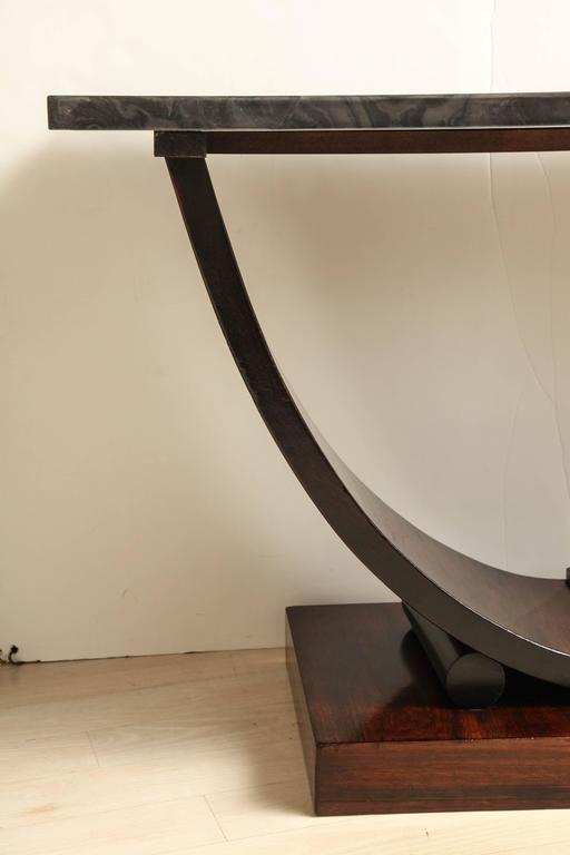 Art deco curule form walnut console table with black wood
