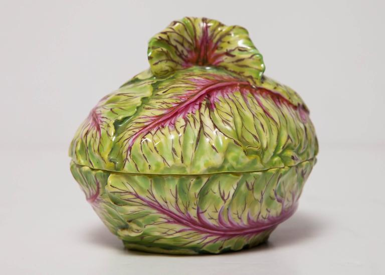 A beautiful and rare early 19th century Meissen porcelain covered box/tureen in the form of a green and red cabbage, naturally modelled and hand-painted in beautiful green and red colors, marked with the under-glaze blue cross swords mark, impressed