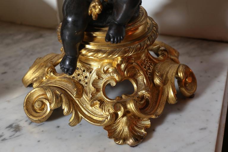 19th Century Three-Piece Gilt and Patinated Bronze Clock Garniture Set For Sale