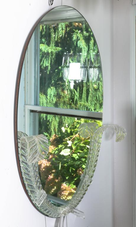 "Lucite detailed oval mirror by the ""Grosfeld House"" company."