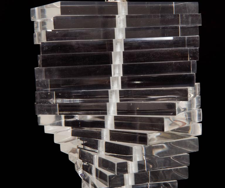 Stacked Lucite blocks twisted to give the helix look of a cascading spiral, Lucite final, no shade.