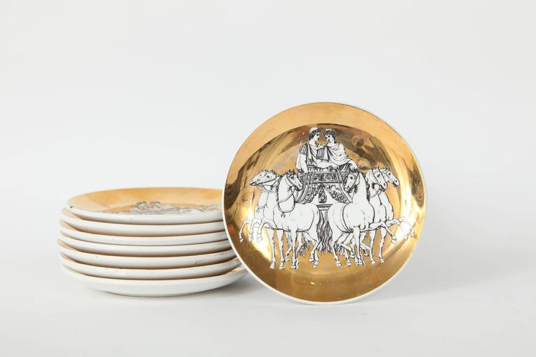 Fantastic set of eight porcelain coasters/nut dishes with a gilded porcelain finish and featuring chariot riders.